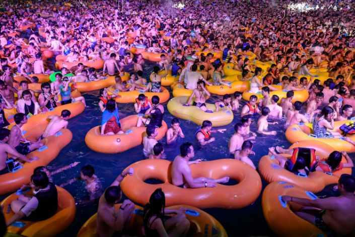 """Partygoers watching the music performance at Wuhan's Maya Beach Water Park on Saturday. <p class=""""copyright"""">STR/AFP/Getty Images</p>"""