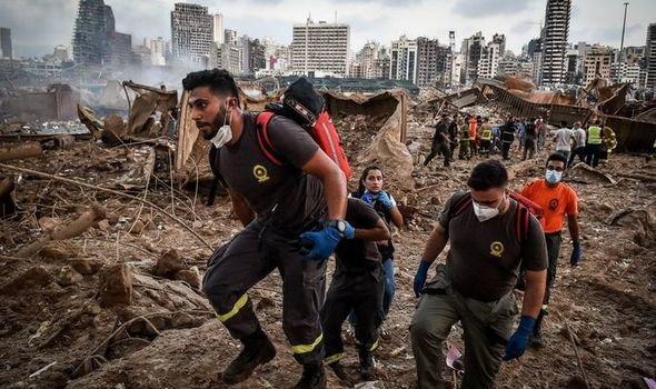 Donate to Beirut: Aid workers walking through rubble