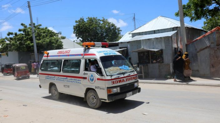 An ambulance is seen near the site of the explosion in Mogadishu