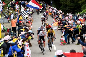 Emirates' Tadej Pogacar (front left) and Jumbo-Visma's Primoz Roglic ahead of Ineos' Egan Bernal (second row left) and Bahrain-Mclaren's Mikel Landa Meana (second row right) are cheered on by fans during Stage 9.