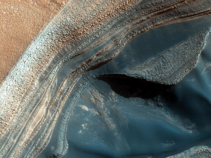 """Layers of ice and dust at the North Pole of Mars, thought to have been deposited over millions of years, photographed by NASA's Mars Reconnaissance Orbiter. <p class=""""copyright""""><a href=""""https://images.nasa.gov/details-PIA18586"""" rel=""""nofollow noopener"""" target=""""_blank"""" data-ylk=""""slk:NASA/JPL-Caltech/Univ. of Arizona"""" class=""""link rapid-noclick-resp"""">NASA/JPL-Caltech/Univ. of Arizona</a></p>"""