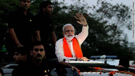 Indian Prime Minister Narendra Modi waves to supporters during his road show for election campaign in Bhubaneswar, India in April 2019.