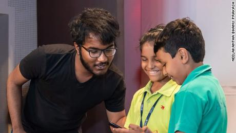Bhanu does the math with two aspiring aspiring young mathematicians.