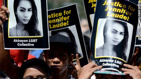 Supporters of the late Jennifer Laude hold up her image during a protest near a Philippine court in Olongapo, north of Manila on February 23, 2015.