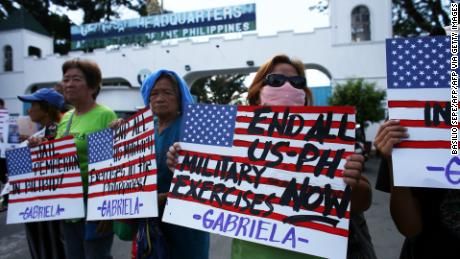 Demonstrators hold placards during a protest in front of the Department of National Defense in Manila on February 21, 2020. Members of the Gabriela Alliance for Women called for the immediate transfer ofof US Marine Joseph Scott Pemberton to the National Bilibid Prison.