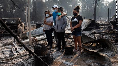 Many families in Phoenix, Oregon returned to asses the wildfire damage to find their homes completely destroyed.
