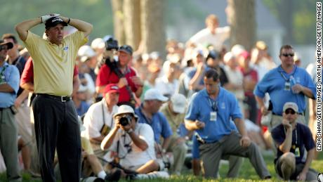 Mickelson waits to hit from the rough during the final round of the 2006 U.S. Open Championship.