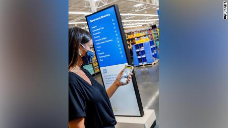 Walmart's new signage imitates an airport.