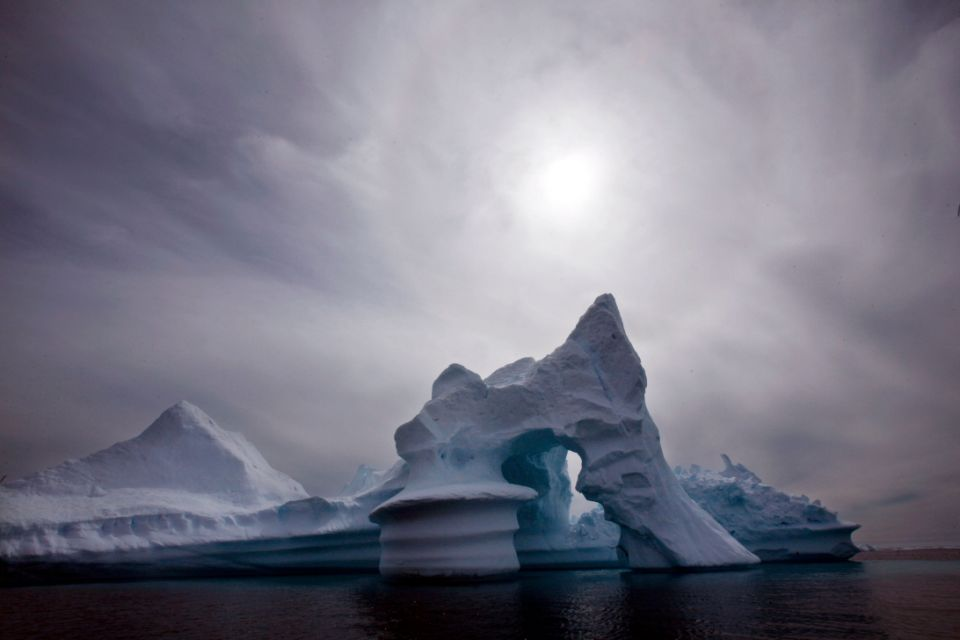This 2007 file photo shows an iceberg melting off Ammassalik Island in Eastern Greenland. A study done on Baffin Island, west of Greenland, found glacial melt uncovered land hidden in ice for more than 40,000 years.