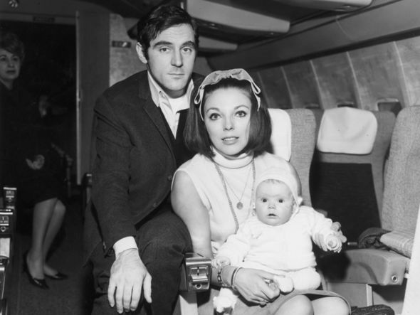 Tara at four months old on a Paris-bound plane with her parents Anthony Newley and Joan Collins