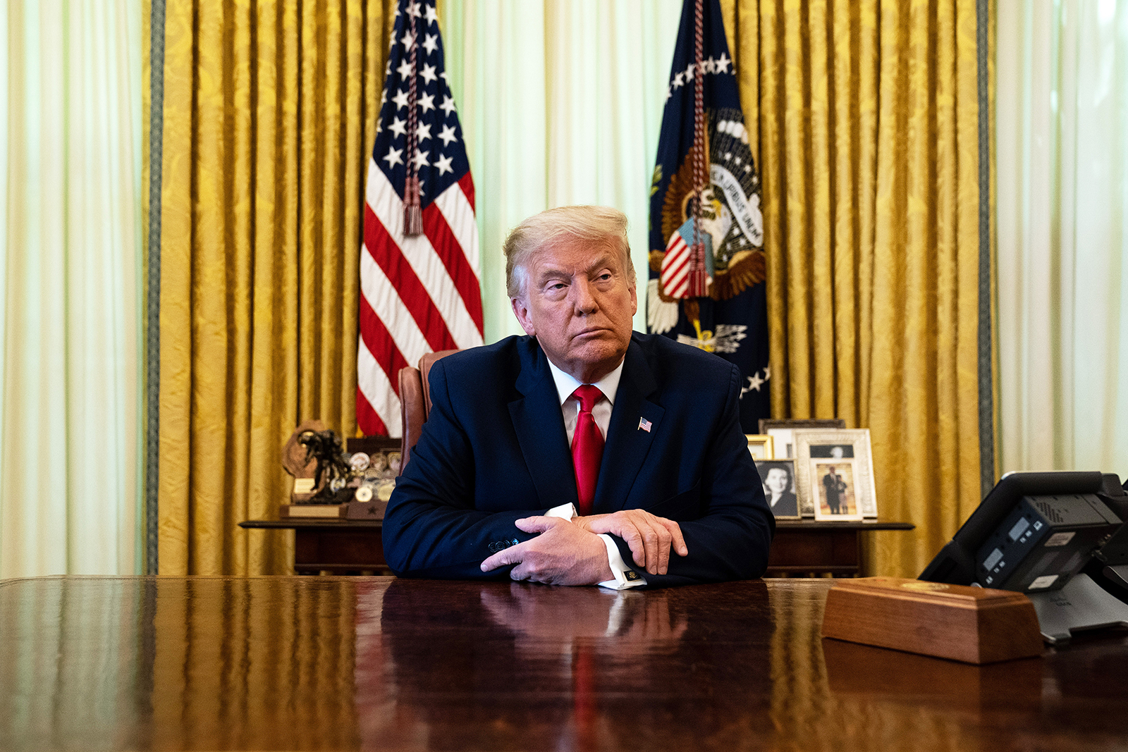 US President Donald Trump listens during an event in the Oval Office of the White House August 28, 2020 in Washington, DC.