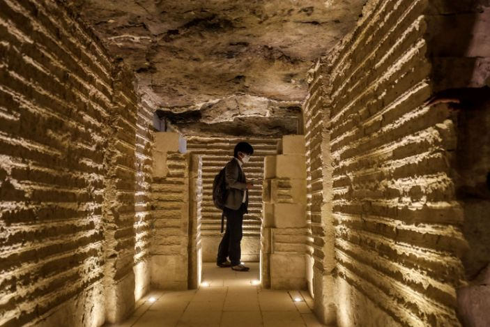 """A journalist tours inside the step pyramid of Djoser in Egypt's Saqqara necropolis, south of the capital Cairo, on March 5, 2020. <p class=""""copyright"""">Mohamed el-Shahed / AFP / Getty</p>"""