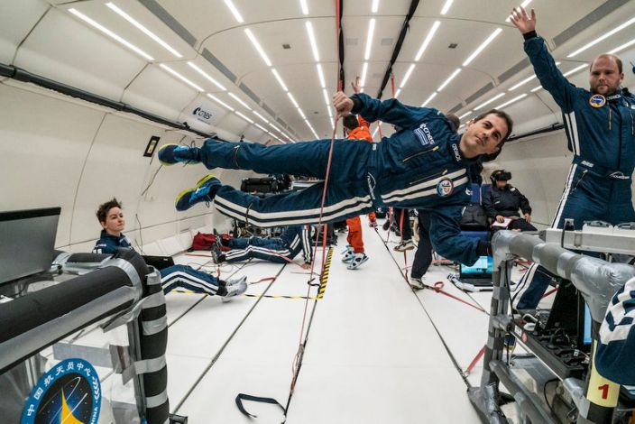 """Participants in the Parabolic Flight Campaign perform a weightlessness exercise in Bordeaux, France, October 16, 2019. <p class=""""copyright"""">Alexis Rosenfeld/Getty Images</p>"""