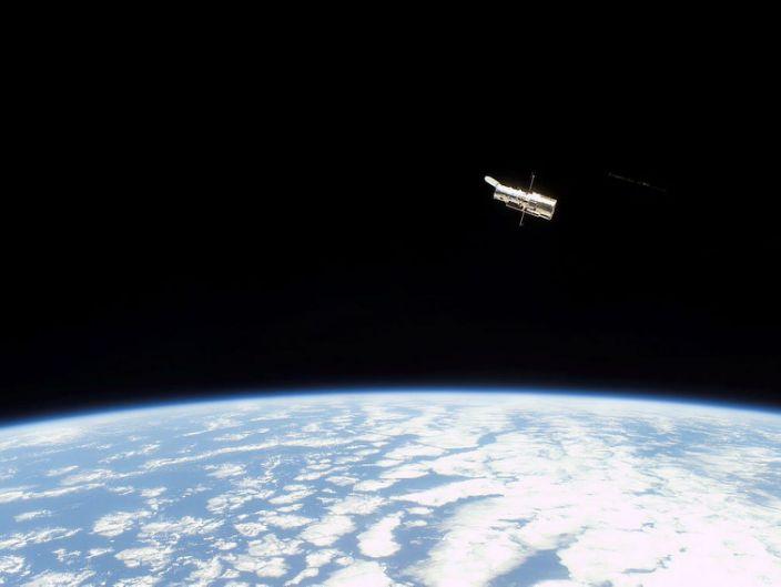 "The Hubble Space Telescope orbits Earth in 2002. <p class=""copyright""><a href=""https://www.spacetelescope.org/images/s109e5706/"" rel=""nofollow noopener"" target=""_blank"" data-ylk=""slk:NASA/ESA"" class=""link rapid-noclick-resp"">NASA/ESA</a></p>"