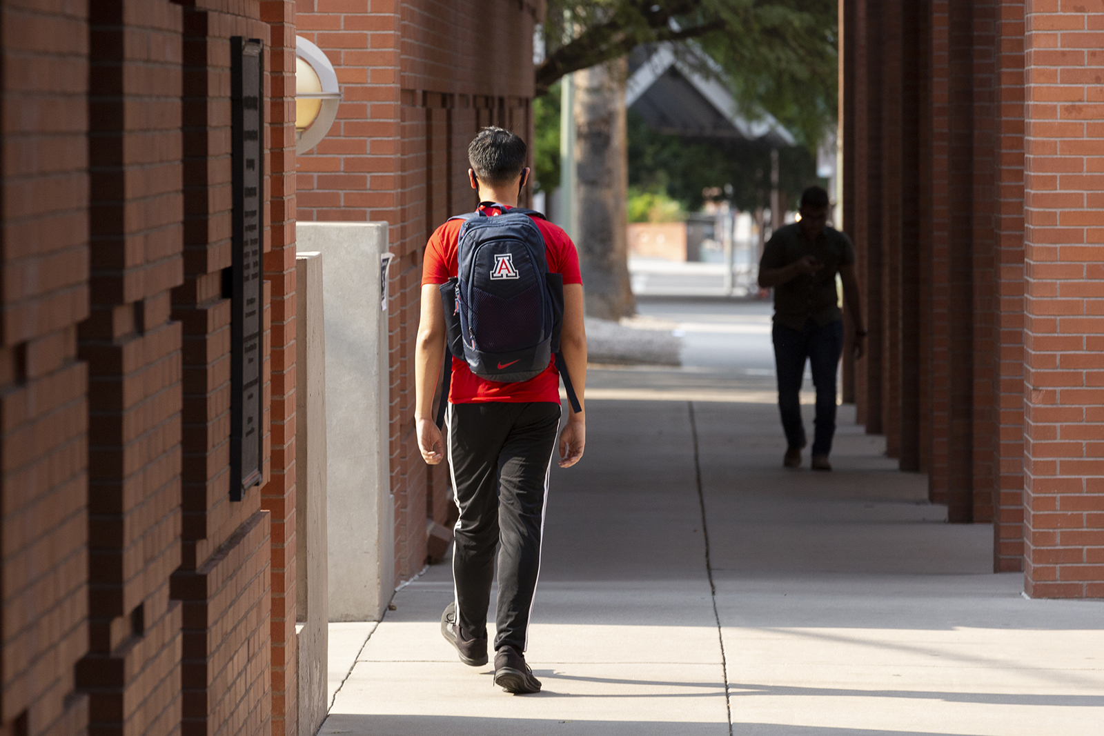 Students walk through the campus at the University of Arizona in Tucson, Arizona, on August 24.