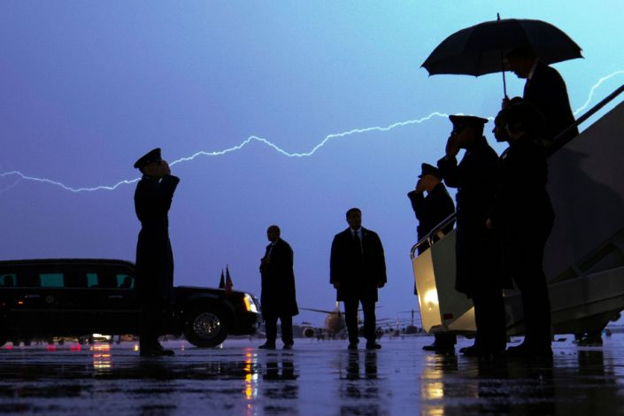 Lightning streaks across the sky as President Donald Trump walks from Air Force One carrying an umbrella as he arrives at Andrews Air Force Base in Maryland after a campaign rally in late August. A poll of subscribers to the Military Times shows him trailing Democrat Joe Biden. (Photo: ASSOCIATED PRESS)