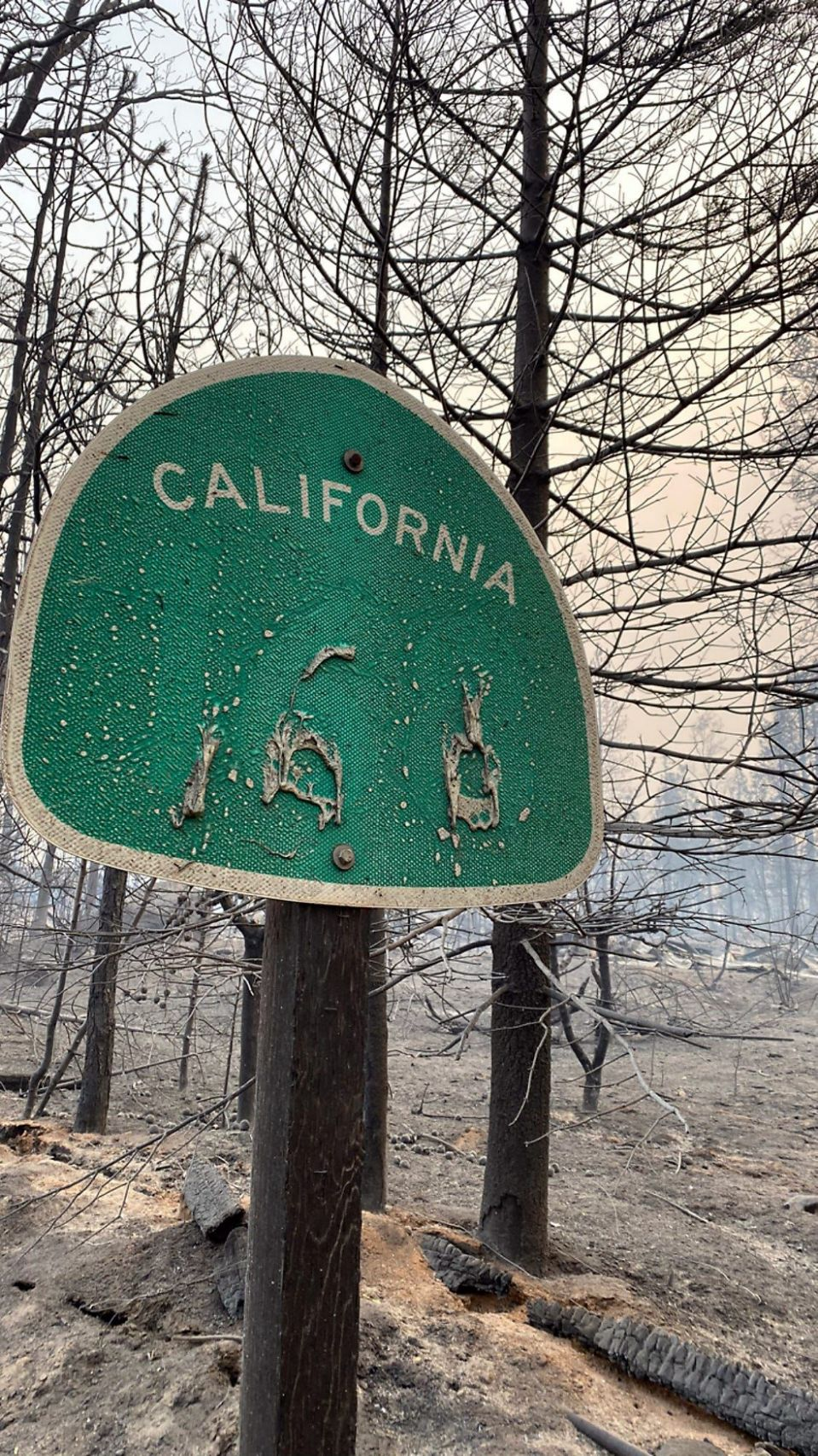 Heat from the Creek Fire melted the lettering off this roadside sign near Shaver Lake, California, on Wednesday, Sept. 9, 2020.