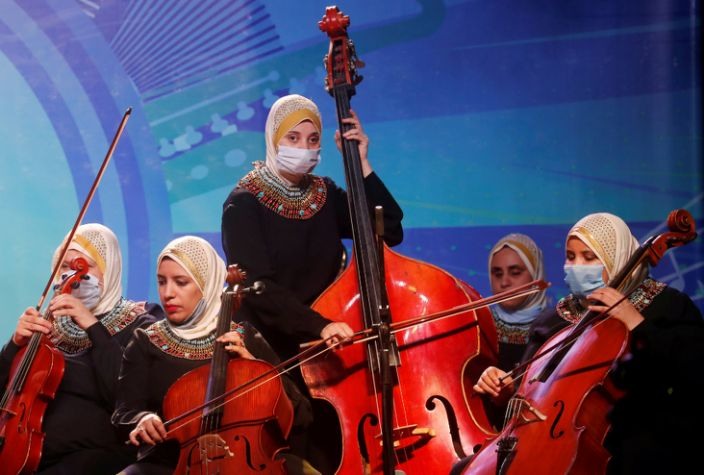 On Sunday, members of the Al-Nour Wal Amal (Light and Hope) chamber orchestra of blind women play during their first concert after months of inactivity because of the coronavirus at the Manasterly Palace in Cairo, Egypt.