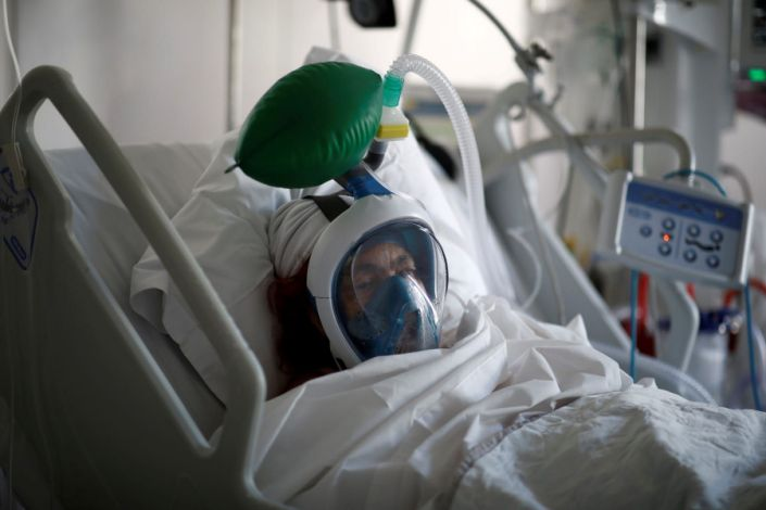 "A patient suffering from coronavirus disease wears a snorkeling mask converted into a ventilator in Paris on April 1, 2020. <p class=""copyright"">REUTERS/Benoit Tessier/File Photo</p>"