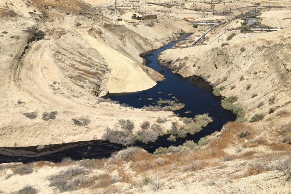 A river of oil spills across the Cymric field near McKittrick, California, in June 2019.