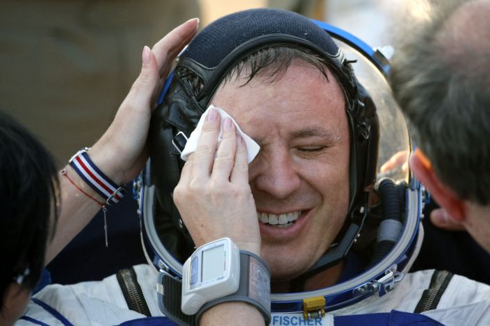 """US astronaut Jack Fischer smiles as a NASA medical staff member wipes his face shortly after he landed back on Earth in a Russian Soyuz capsule in Kazakhstan, September 3, 2017. <p class=""""copyright"""">Sergei Ilnitsky/AFP/Getty Images</p>"""