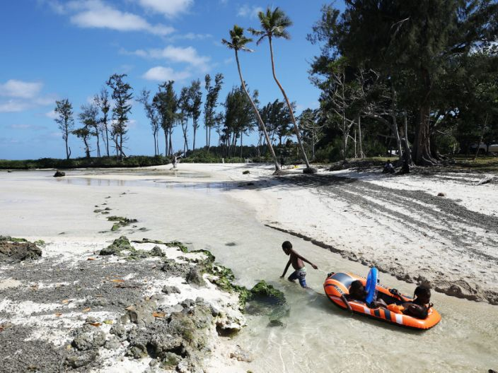 "Kids play at Eton Beach on November 30, 2019 in Efate, Vanuatu. Satellite data show sea level has risen about 6mm per year around Vanuatu since 1993, a rate nearly twice the global average, while temperatures have been increasing since 1950. 25 percent of Vanuatu's 276,000 citizens lost their homes in 2015 when Cyclone Pam, a category 5 storm, devastated the South Pacific archipelago of 83 islands while wiping out two-thirds of its GDP. Scientists have forecast that the strength of South Pacific cyclones will increase because of global warming. Vanuatu's government is considering suing the world's major pollution emitters in a radical effort to confront global warming challenges and curb global emissions, to which it is a very small contributor. <p class=""copyright"">(Photo by Mario Tama/Getty Images)</p>"
