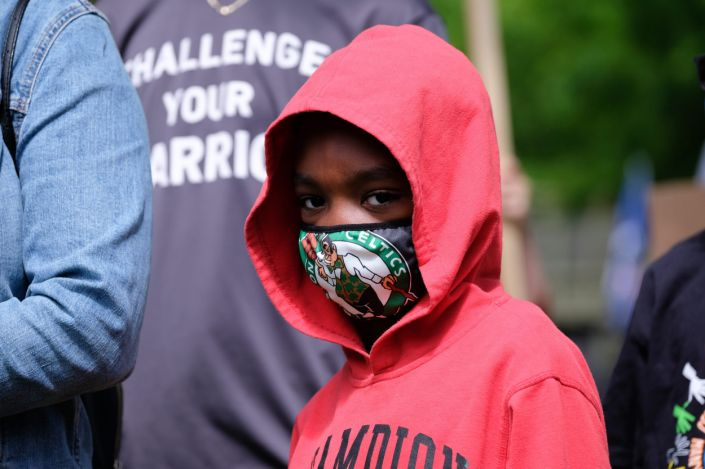 """A young boy wears a mask during a vigil for George Floyd in Pennsylvania on May 31, 2020. <p class=""""copyright"""">Preston Ehrler/SOPA Images/LightRocket via Getty Images</p>"""
