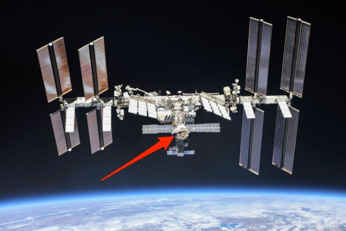 """The International Space Station, with an arrow pointing to the Zvezda module. <p class=""""copyright"""">NASA</p>"""