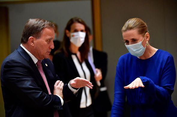 EU: Lofven speaks with Denmark's Prime Minister Mette Frederiksen in July in Brussels