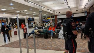 Passengers in airport after police called over a mask dispute with a baby