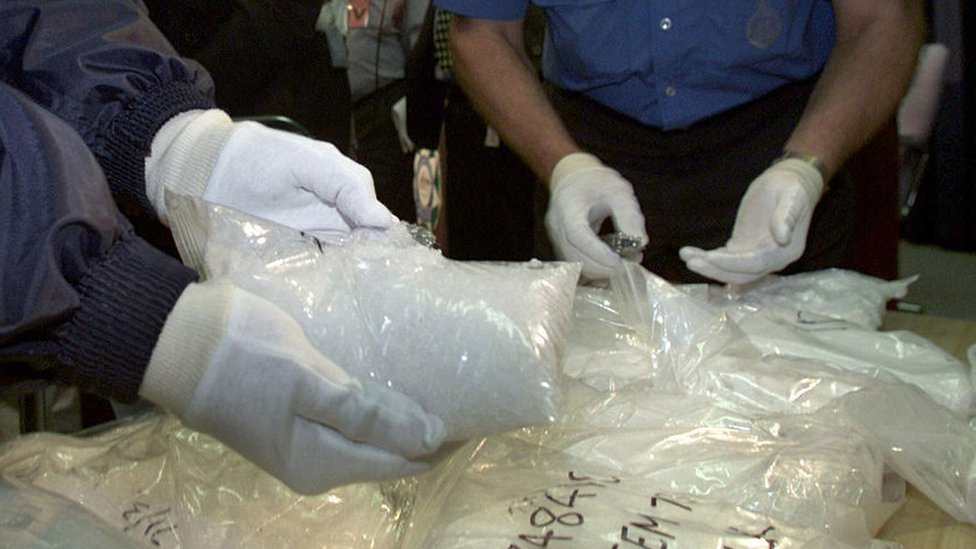 Australian police sort through seized drugs in December 2000