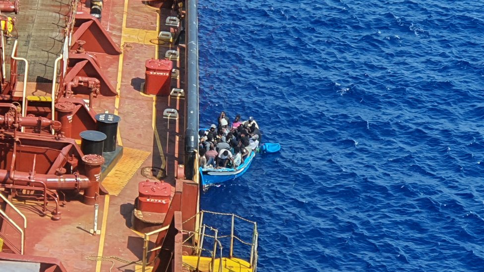 A group of migrants picked up by the Danish tanker Maersk Etienne