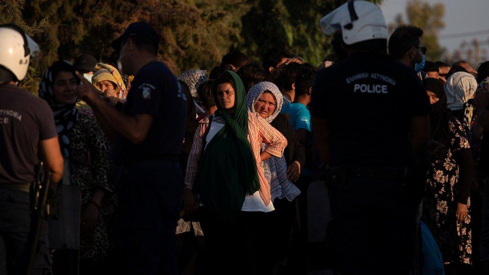 Migrants and refugees waiting to check in at temporary camp Kara Tepe