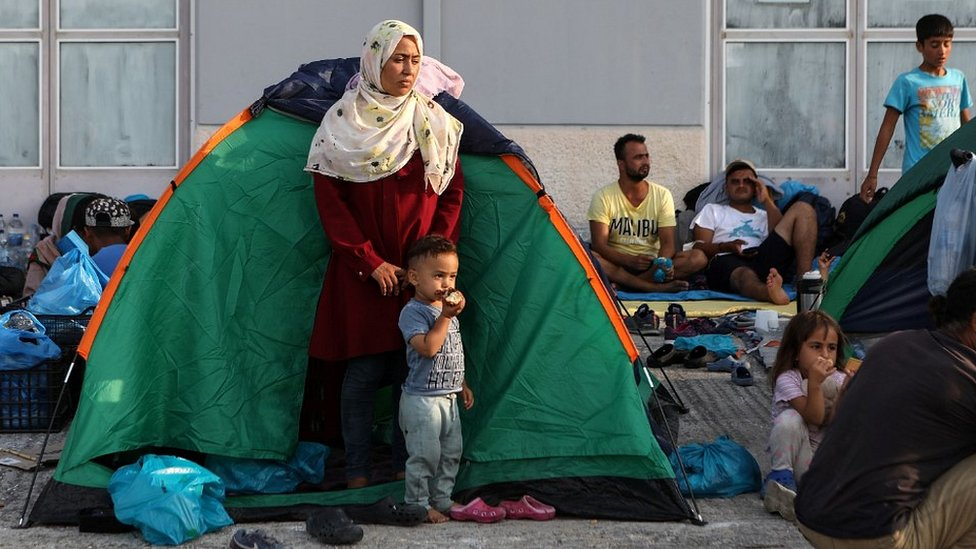 Migrants near burnt-out Moria camp, 16 Sep 20