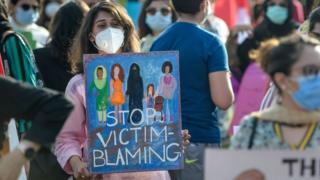 Human rights activists carry placards as they take part in a protest against an alleged gang rape of a woman, in Islamabad on September 12, 2020.