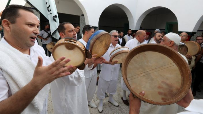 A Sufi committee performs religious songs and dances to commemorate the life of the saint, Sidi Omar Boukhtiwa, in Tunis, Tunisia, on Sunday.