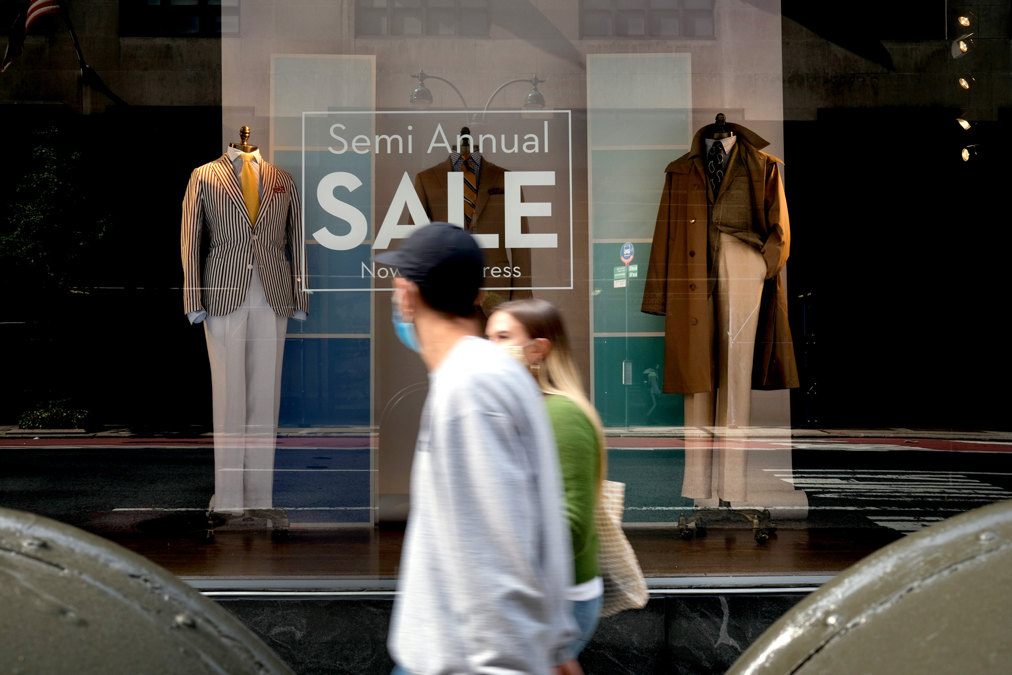 Men's business attire is displayed in the window of a Manhattan clothier on September 15 in New York City.