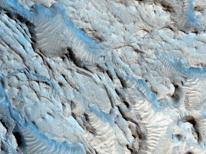"""The southern section of the Cydonia Region of Mars is dominated by a series of craters and the remnants of channels that may be from a past river system, photographed by NASA's Mars Reconnaissance Orbiter. <p class=""""copyright""""><a href=""""https://images.nasa.gov/details-PIA20046"""" rel=""""nofollow noopener"""" target=""""_blank"""" data-ylk=""""slk:NASA/JPL-Caltech/Univ. of Arizona"""" class=""""link rapid-noclick-resp"""">NASA/JPL-Caltech/Univ. of Arizona</a></p>"""