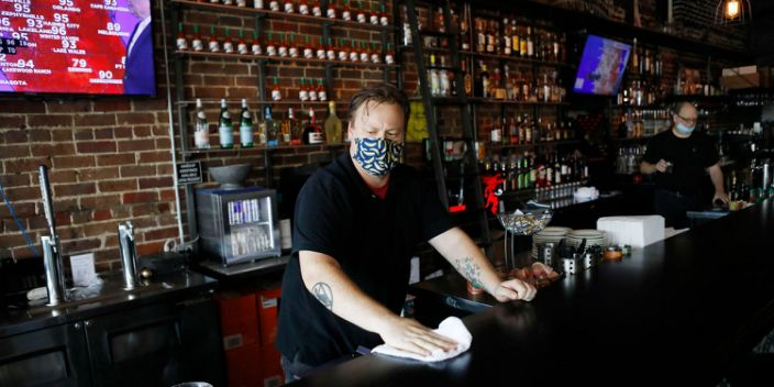 "Zack Vermes a bartender at Carmines Ybor Italian restaurant wipes off the bar while awaiting patrons on June 26, 2020 in Tampa, Florida. <p class=""copyright""><a href=""https://www.gettyimages.com/detail/news-photo/zack-vermes-a-bartender-at-carmines-ybor-italian-restaurant-news-photo/1223045110?adppopup=true"" rel=""nofollow noopener"" target=""_blank"" data-ylk=""slk:Octavio Jones/Getty"" class=""link rapid-noclick-resp"">Octavio Jones/Getty</a></p>"