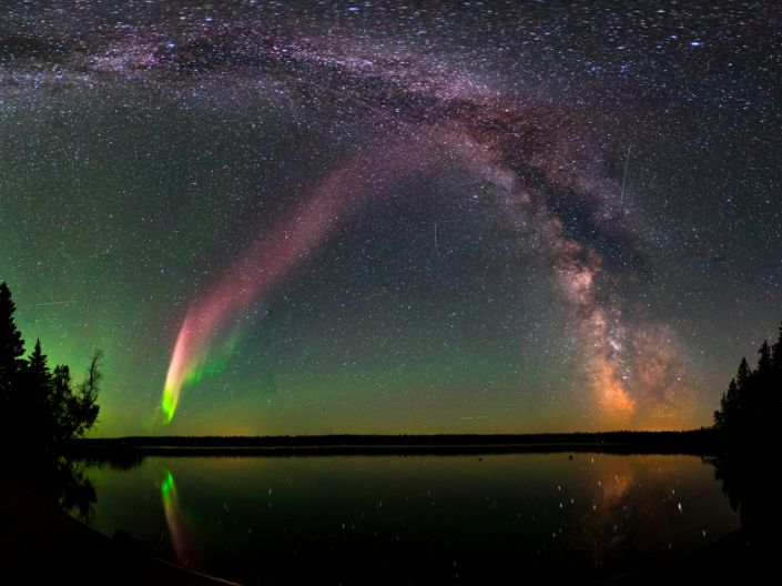 """STEVE (Strong Thermal Emission Velocity Enhancement) and the Milky Way at Childs Lake, Manitoba, Canada <p class=""""copyright"""">Krista Trinder/ NASA Goddard Space Flight Center</p>"""