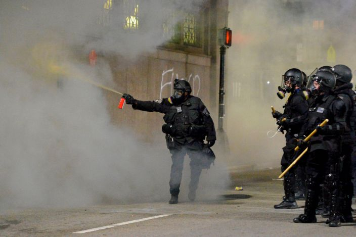 """Police shoot pepper spray at a protester in Boston, Massachusetts, on May 31, 2020. <p class=""""copyright"""">Joseph Prezioso/AFP via Getty Images</p>"""
