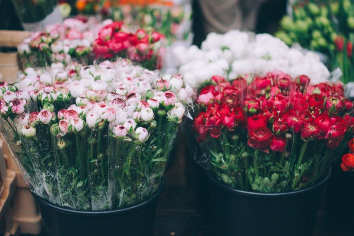 """Flowers in buckets at a shop. <p class=""""copyright"""">Unsplash/Alisa Anton</p>"""
