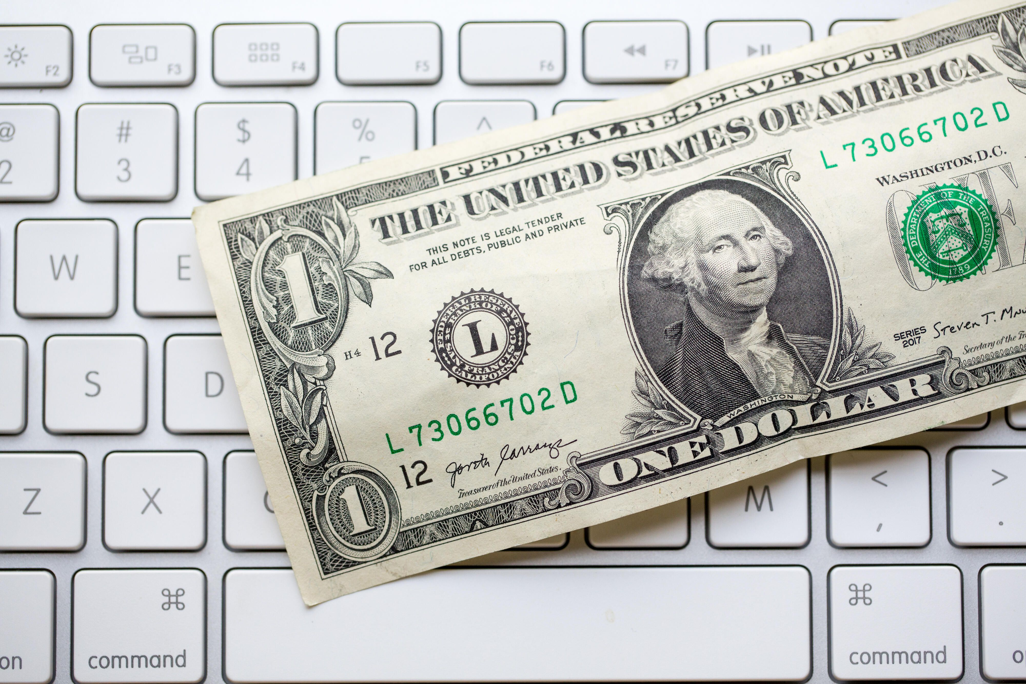 money-dollar-bills-cash-stimulus-taxes-covid-coronavirus-america-7073