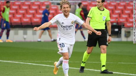 Modric celebrates after scoring against Barcelona.