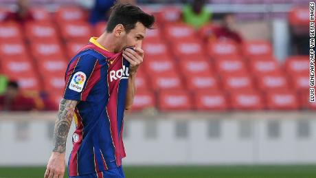 Messi looks on during the match against Real Madrid.