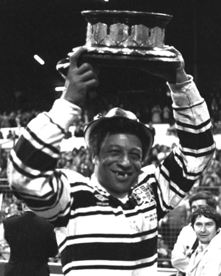 Clive Sullivan, the first black player to captain a British national side in any sport, raises the Challenge Cup while playing for Hull.