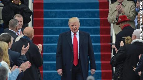Donald Trump arrives on the platform at the US Capitol for his swearing-in ceremony on January 20, 2017.