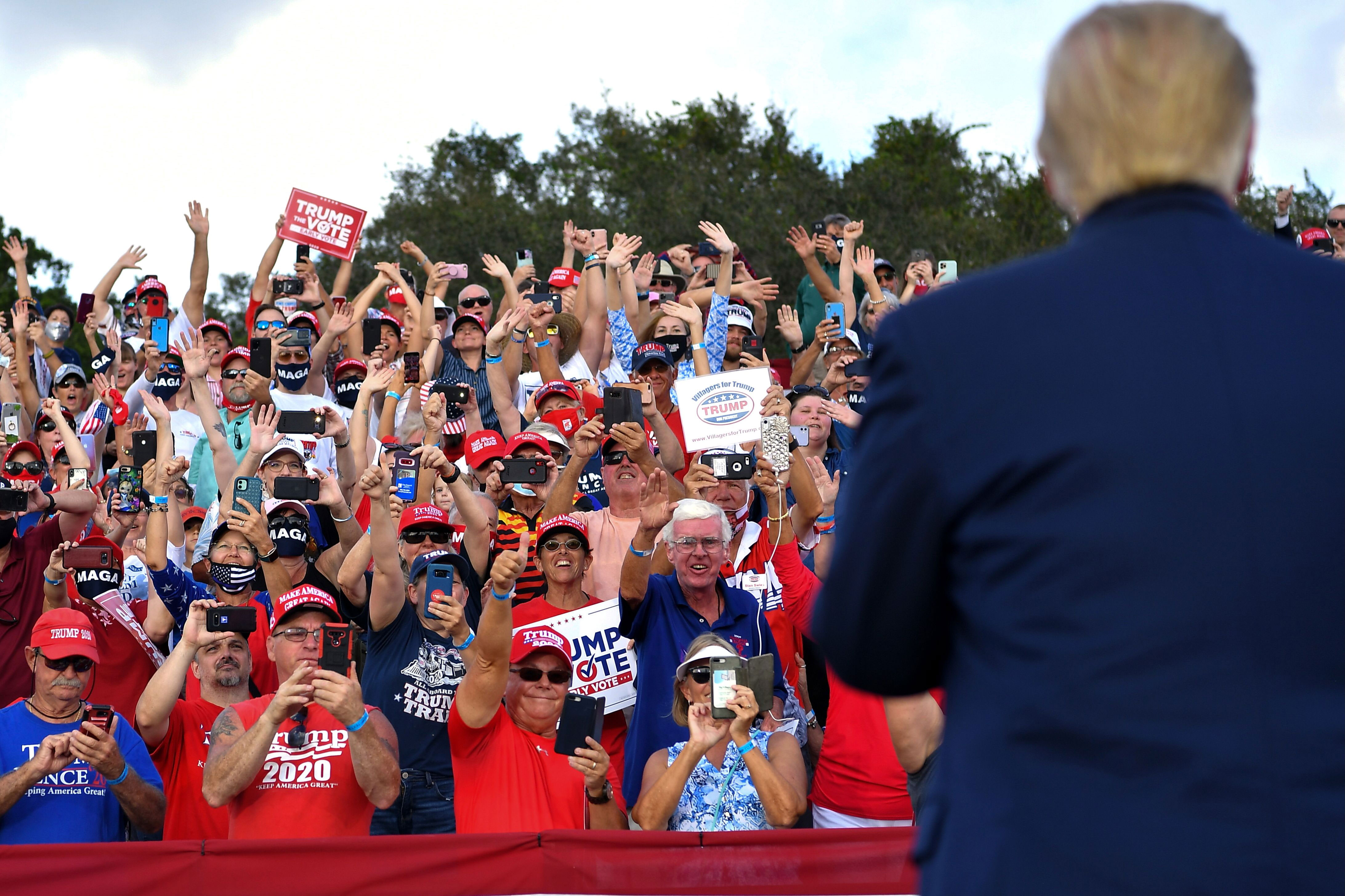 Supporters cheer as President Donald Trump arrives for a campaign rally in The Villages, Florida, on October 23.