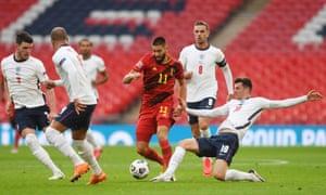 England's Declan Rice, Kyle Walker, Jordan Henderson and Mason Mount attempt to halt Belgium's Yannick Carrasco on Sunday.