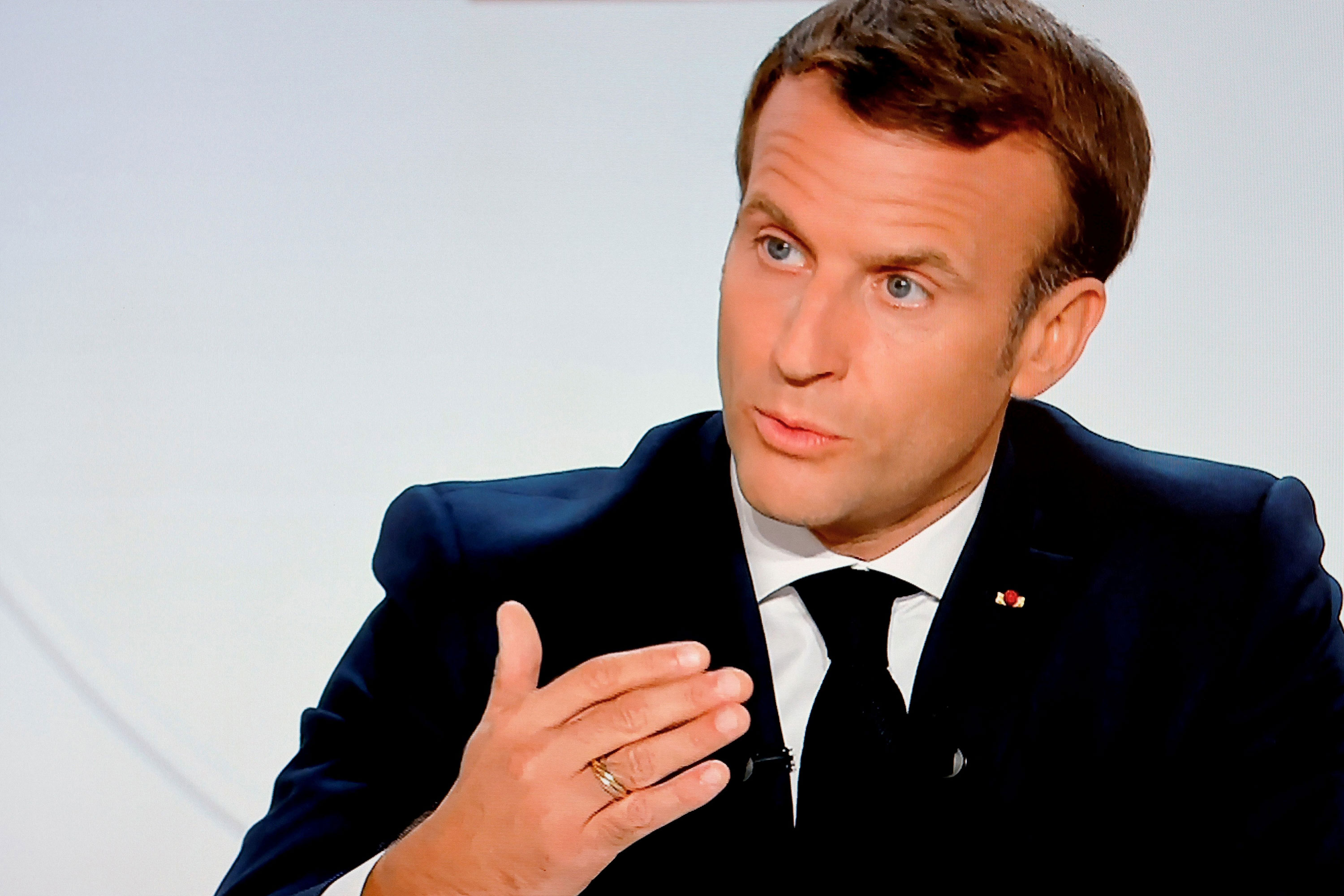 French President Emmanuel Macron addresses the nation during a televised interview from the Elysee Palace on October 14 in Paris.